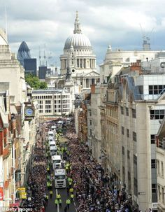 A general view of The Victory Parade as it passes along Fleet Street