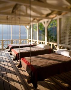 Hanging beds on a lake house sleeping porch. WOW!