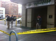 Oakland's Oaksterdam University was taken over by federal officials Monday morning.    Officers wearing U.S. Marshals, IRS and DEA jackets swarmed the Oakland medical marijuana facility before 8 a.m. Monday.    Yellow tape was keeping everyone away.