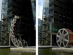 UK-based design firm Heatherwick Studio created this 39-foot timber and steel bridge in 2004 to act as a walkway over a small section of London's Grand Union Canal.  I love this!