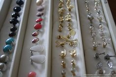 I only wear studded earrings and I lose them so easily. To make a quick storage/organization box, simply cover some strips of Styrofoam with a thin cloth and stick the backs into the foam. Looks pretty easy.