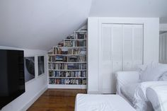 eclectic family room by Esther Hershcovich; love all the bookcases built in in this bedroom