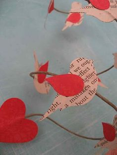 old book pages punched out to make birds
