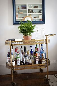 Vintage beverage cart....great idea for a bar in our house
