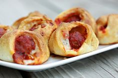 Meatball Sliders - I can't wait to make these!!  Ingredients 1 bag frozen Italian Style meatballs (32 meatballs) 1 jar (28 oz.) pasta sauce 2 cans refrigerated crescent rolls 11 slices mozzarella cheese, cut into thirds  Directions Preheat oven to 375 degrees. Simmer meatballs and sauce over low heat until warmed through (5-10 minutes). Separate crescent rolls into triangles. Cut eat triangle in half to form two triangles. Place 1/3 slice of mozzarella cheese on top of each crescent roll, top...