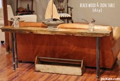I LOVE this rustic DIY table made with plumbing supplies! (great tutorial included)