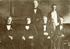 This photograph of Polk and his cabinet (minus Sec. of State James Buchanan) is not only the first photo of a President and his cabinet, but it is also the first interior photograph of the White House. The photograph was taken by John Plumbe in the State Dining Room and shows new wallpaper and chairs purchased by the Polks. Reflected in the mirror is a crystal chandelier and behind the group is an ornate Italian mantle purchased by President James Monroe.