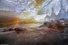 An air pocket created between layers of ice under the Tianuksa river, Russia. Amazing. photographed by Yuri Ovchinnikov