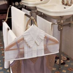 Wooden hanger wearing a shirt collar with organdy old nightdress