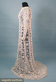 """IRISH CROCHET WEDDING GOWN, c. 1910. Lot: 500. March/April 2005 Vintage Clothing & Textile Auction, New Hope, PA.  Long sleeved & trained, unlined, B 36"""", W 29"""", L 59-70"""", excellent.     Price Realized: $ 1150.00      Category: Womens      Era: 1890-1920      Condition: Excellent"""