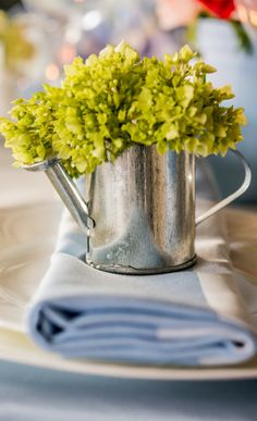 pretty table setting watering can