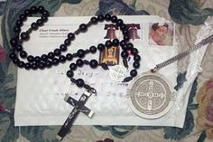 A Journey of Faith: A Benedictine DVD, rosary, and medal serve as breadcrumbs through the dark forest?