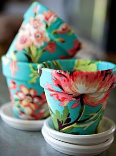 flower pots covered with fabric and then covered with modge podge.... awesome.