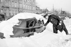A cop tags a car parked at Avenue H and Flatbush Avenue in Brooklyn Dec., 1947