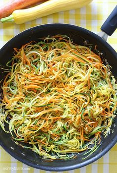 zucchini, yellow squash and carrots cut into spaghetti like strands and sauteed with garlic and oil..