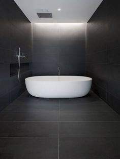 :: BATHROOMS :: Love the concept of spa rooms combining the bath & shower into one space. Wish our building codes weren't so strict so that bath tubs could overflow the edge. Lovely detail with the hidden cove lighting.   Private Residence in San Francisco  Designer:Garcia Tamjidi Architecture Design  Location: USA  #bathrooms