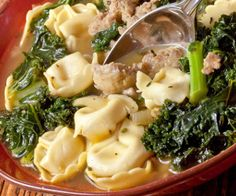 Slow cooker tortellini soup with kale.Delicious Italian soup cooked in slow cooker.