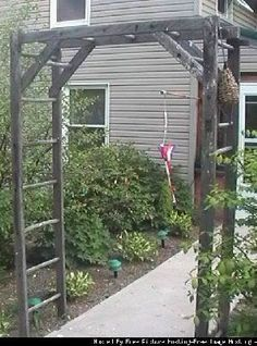 Old Ladders...re-purposed into a prim garden arbor.