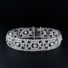 French Art Deco Platinum Diamond Bracelet with open work design. 12.0 cttw, 488 full cut diamonds VS/H-I. Circa 1930s