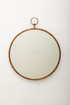 Love this wall mirror! | @Anthropologie