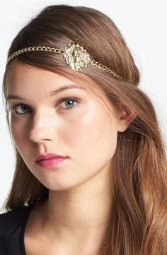Add some shine to your 'do with a medallion head wrap.