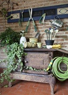 Old cook stove recycled into a potting bench