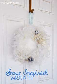 Beautiful Feathery White Snow Inspired Wreath at thebensonstreet.com #snow #feathers #wreath