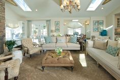 Traditional contemporary with a hint of beach. I love the subtle zebra print fabric on the chairs and the mix of turquoise tones in the room. | Bella Interiors - Casual Elegance in Westport