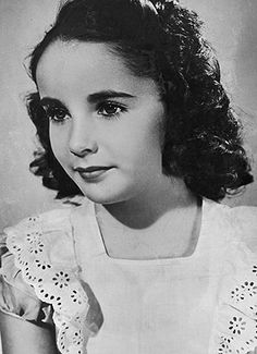 Elizabeth Taylor as a young girl. She was born with a gene mutation causing her to have double rows of eyelashes. Her eyes were stunning large & blue & when caught by the light, were almost violet.