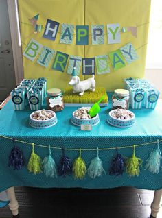 Blue and green backdrop, dessert table and banner at a Puppy birthday party! See more party planning ideas at CatchMyParty.com!