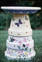 hand painted glazed clay pots stacked and glued for a bird bath