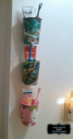 Kids Bathroom toothbrush, toothpaste and rinse cup storage. Maybe do it with a Velcro strip, or have a small shelf at counter height with the kids cups sitting on it.