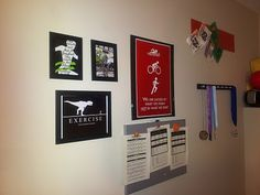 My ego wall with a homemade medal hanger, race medals, race bibs and motivation signs.