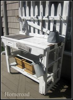 potting bench - old window frame for the side and picket fence for the back...