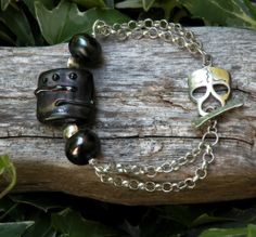 She only wears Black,Alternative lifestyle,Goth Girl Rock n Roller, Urban Heat, Black, Bad Girl, Citypunk, Oil Slick. Skull love - $66.00 - Handmade Jewelry, Crafts and Unique Gifts by Indian Mound Fossil and Stone #skulls #bracelet #handmadejewelry #statementjewelry #uniquebracelet