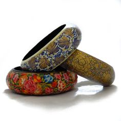 We love this new chunky bangles, handpainted on wood. Handpainted Big Wooden Bangle  Price : $12.50 http://shop.amnestyusa.org/Amnesty-International-Handpainted-Wooden-Bangle/dp/B00B8CR2X2