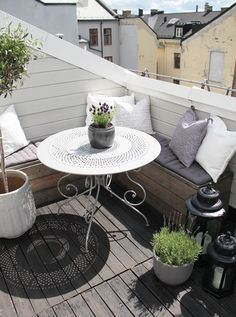 BALCONY: small balcony idea: bench to use cornerspaces, and a round iron table to make it look less massive - small desk perhaps?