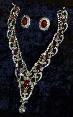 Queen Elizabeth's ruby and diamond earrings formerly belonging to Queen Mary, and the ruby and diamond necklace was given to the Queen by her parents as a wedding gift.