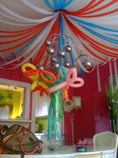 MORE STREAMERS... Lots more, but the right Idea, --- and then twisted down the walls, Streamers are 50 cents a roll.