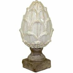 """Ceramic artichoke finial.    Product: FinialConstruction Material: CeramicColor: IvoryDimensions: 11"""" H x 6"""" DiameterCleaning and Care: Wipe with clean damp cloth"""