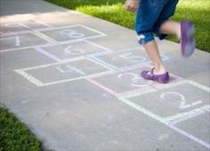 Not all kids play requires batteries and a flat screen. Long before electronics, chalk games were used to create family fun. Chalk games can teach numbers, letters, problem solving and can even help develop coordination and promote muscle development.