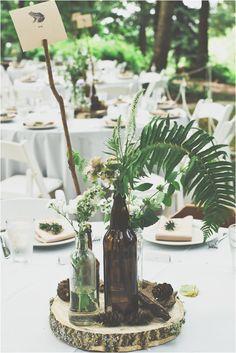 wildflower centerpiece, photo by Hazelwood Photo http://ruffledblog.com/two-artists-marry-atop-columbia-gorge #centerpieces #ferns #weddingideas