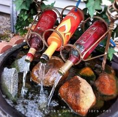 reuse wine bottles for a diy fountain :) but will use mason jars! Would be more awesome if there was a light making the water look like wine....... this is an awesome idea! - Click image to find more Gardening Pinterest pins