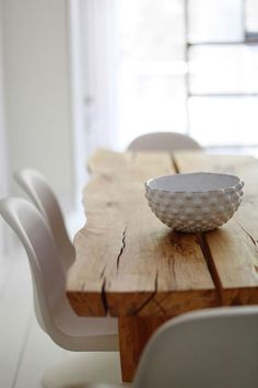love the contrast between the Panton chairs and the rough wood table