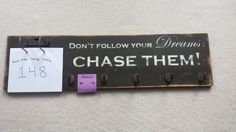 """Marathon tri-athalon medal and bib display board. Rustic DIY with runner quote """"Don't follow your dreams: chase them! """""""