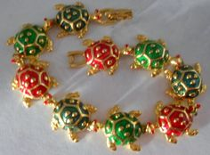 'Cloissone Christmas Turtles Bracelet' is going up for auction at 12pm Mon, Dec 3 with a starting bid of $7.
