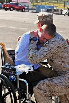Lance Cpl. Jason Hallett and Staff Sergeant Michael R. Gilio, both of India Company, 3rd Battalion, 5th Marine Regiment, are reunited at the unit's homecoming from Afghanistan earlier this week. Hallett has been recuperating at Bethesda Naval Medical Center since being wounded in October 2010.