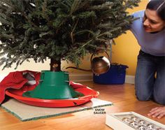 Keep Christmas tree stand water from leaking onto (and potentially damaging) wood flooring with a plastic snow saucer.