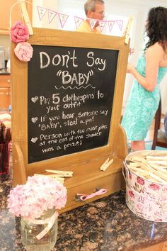 """""""Don't say baby"""" game - guests pin clothes pins to their shirt. If someone says the word baby another guest is allowed to take a pin from them. The person with the most pins at the end of the party wins a prize."""