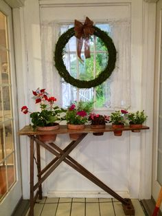 Antique ironing board planter... what a great idea for those old wood boards. Love it on the porch or in the garden...